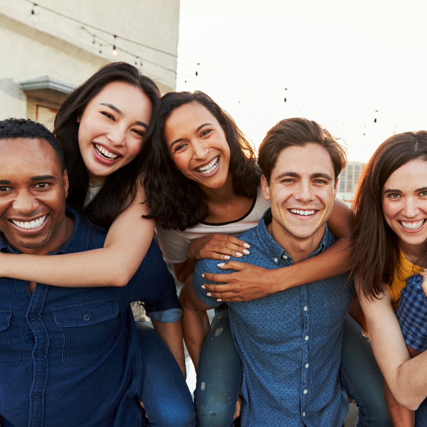 Group of adults hugging and smiling
