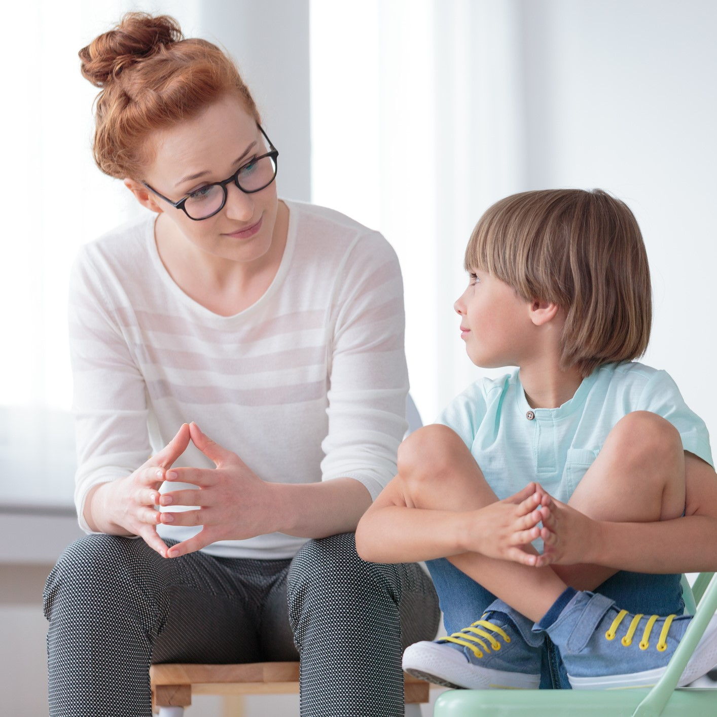 School psychologist having serious conversation with a child.