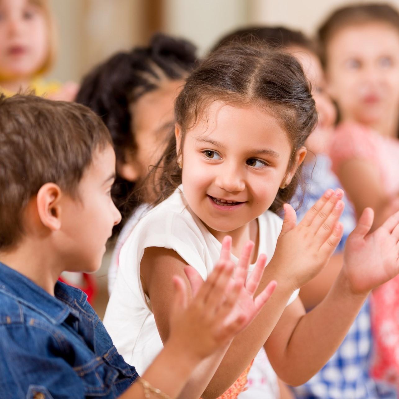 Preschool children playing in classroom.