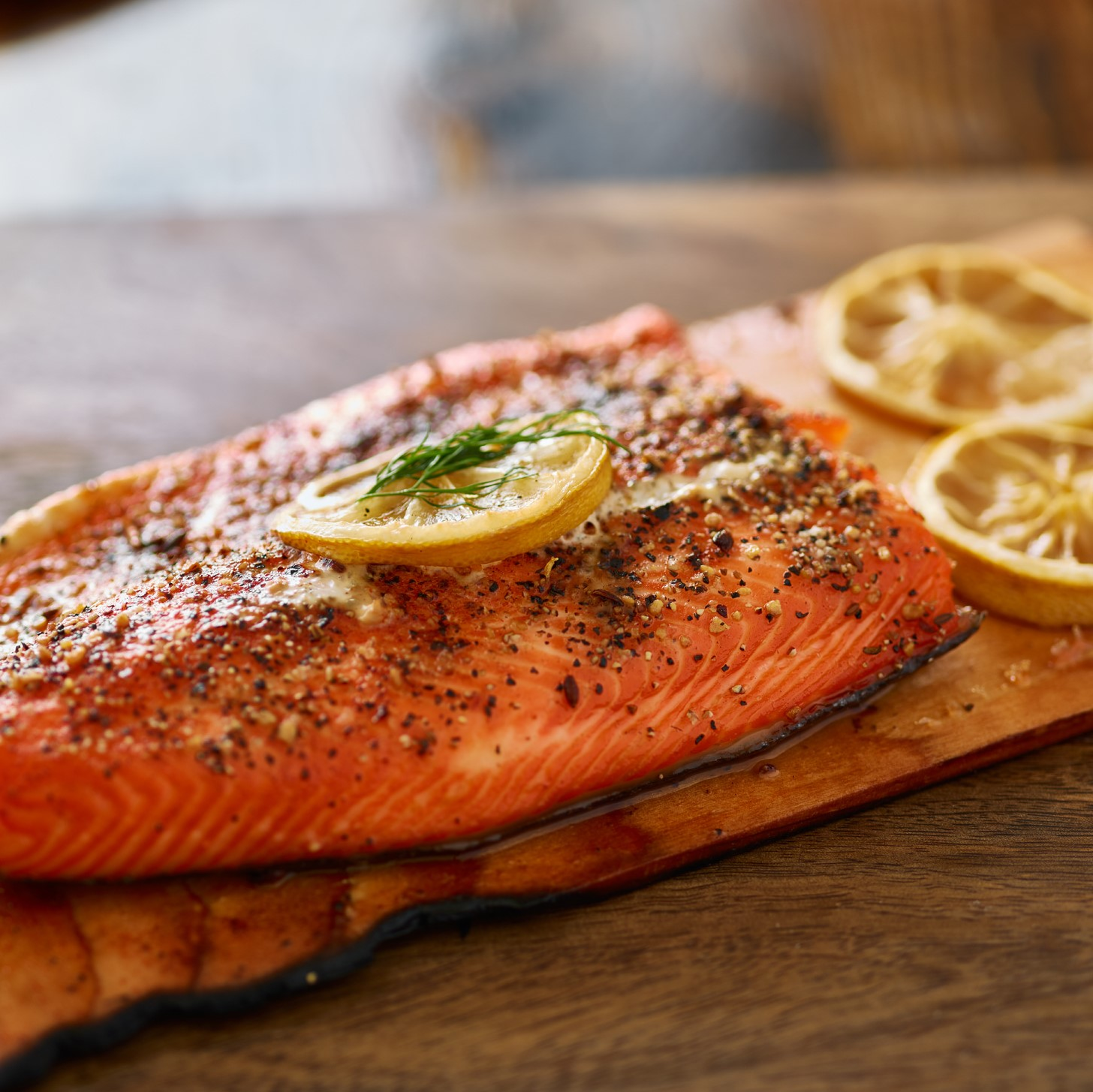 Cooked cedar planked salmon with lemon and dill meal