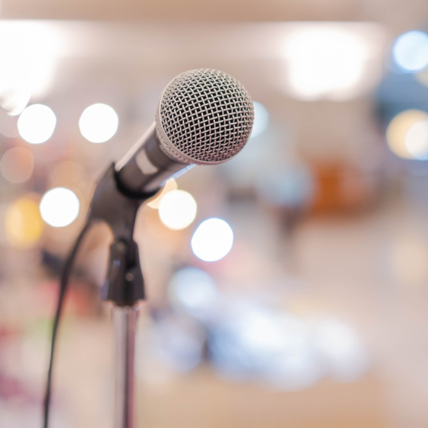 Close up microphone in conference hall