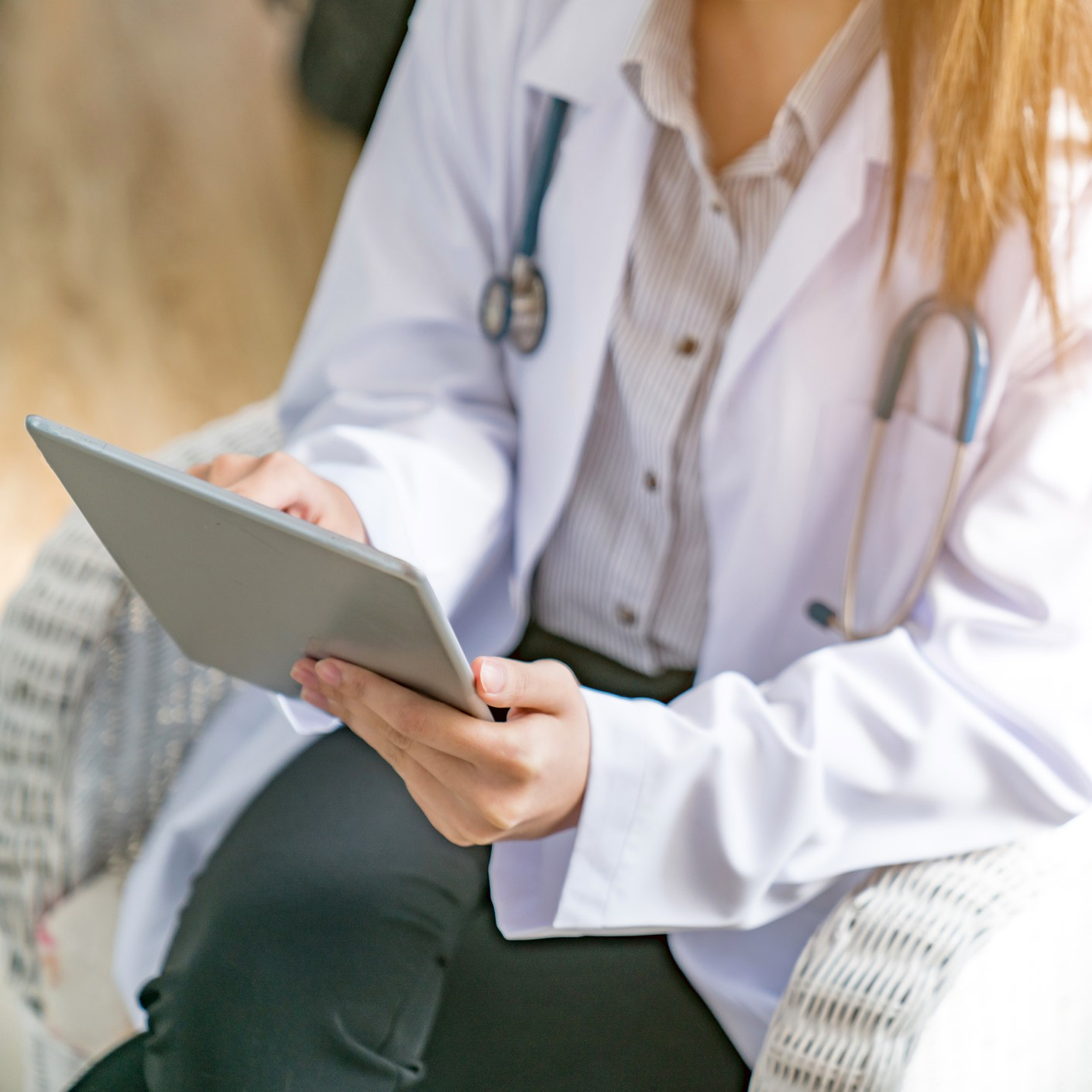 Doctor on tablet